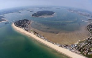 An aerial view of Poole Harbour with Sandbanks Beach, Dorset // Kiterr.com